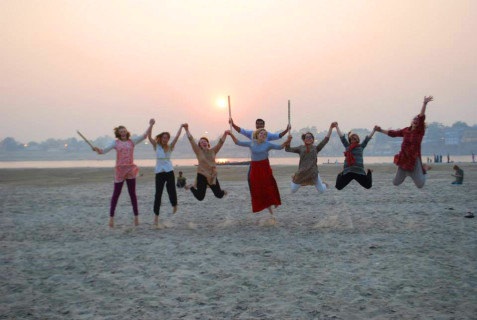 Jumping for joy after playing cricket until sunset.